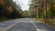 WS POV View of driving on two lane highway during autumn with beautiful foliage / Upstate New York, United States