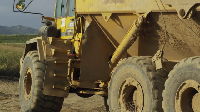 WS View of dump truck driving through scene / Malaga, Andalusia, Spain