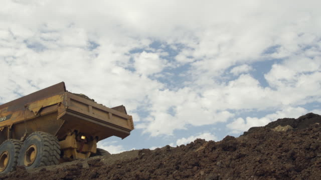 WS View of dump truck unloading earth / Malaga, Andalusia, Spain