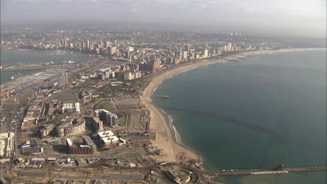 WS POV AERIAL View of Durban harbour entrance and uShaka Marine World / Durban, Kwazulu-Natal, South Africa