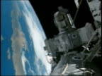 2005 view of Earth from Space Shuttle Discovery with International Space Station in foreground / STS 114