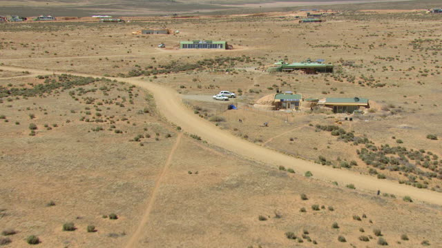 WS AERIAL View of Earthships houses in Taos County / New Mexico, United States