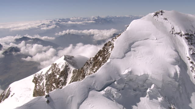 WS AERIAL View of east and west peak and mountaineers on ridge / Lyskamm, Valais, Switzerland