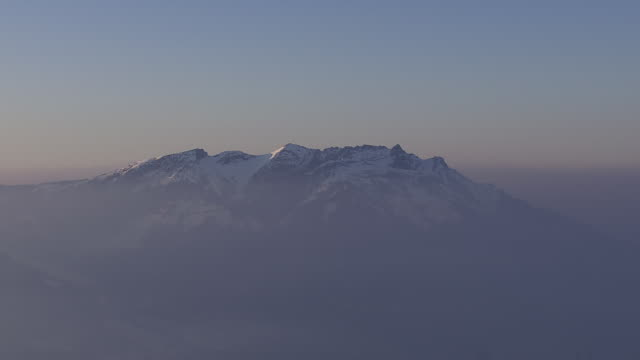WS AERIAL PAN View of Eiger mountain with clouds / Switzerland