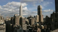 WS T/L View of empire state building and surrounding rooftops / New York City, New York, USA