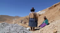 WS View of family working in mining / Potosi Bolivia
