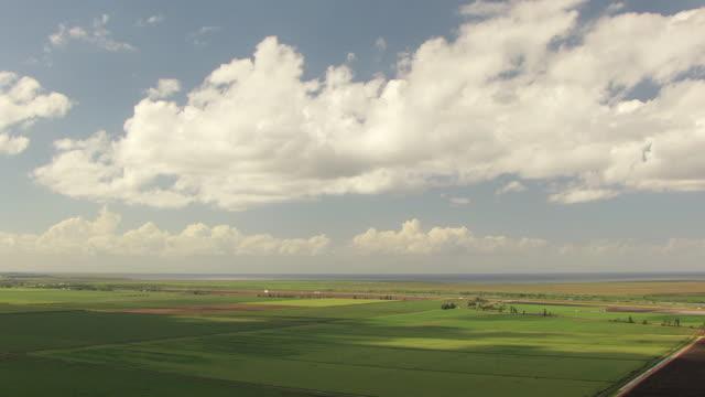 WS AERIAL View of farm land along highway / Lake Okeechobee, Florida, United States