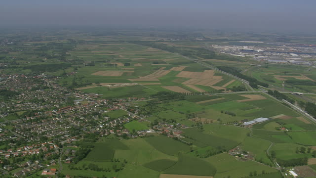 WS AERIAL PAN ZI View of farm land with village at Antwerp Docks / Flemish Region, Belgium
