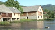 WS PAN View of farmers buildings on lake in village / Makarska, Croatia