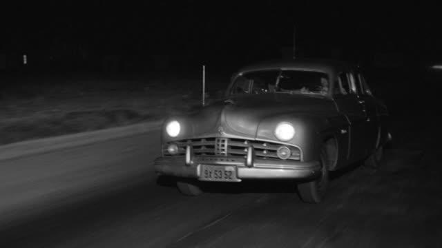 WS View of fast moving car rural area nondescript sedan follows close