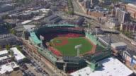 WS AERIAL POV View of Fenway park stadium with city / Boston, Massachusetts, United States