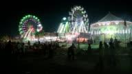 WS PAN View of ferris wheel in motion at night during Fair / Pushkar, Rajasthan, India