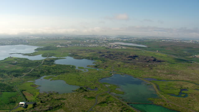 WS AERIAL View of field and houses / Iceland