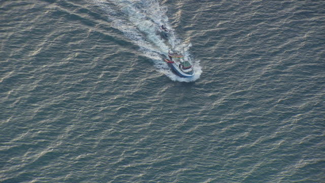 WS AREAIL View of Fishing boat moving in water / Iceland