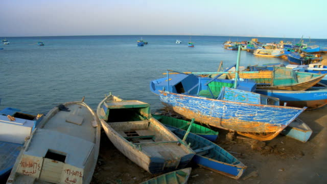 WS PAN View of fishing boat near shore at red sea bay / Hurghada, Red Sea coast, Egypt