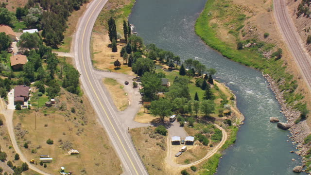 WS AERIAL ZO View of floating river in valley besides road and railway track / Wyoming, United States
