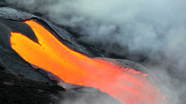MS View of flowing molten lava river and forming volcanic steam cloud at morning / Kalapana, Hawaii, USA