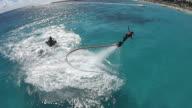 WS AERIAL TS View of Flyboarding in Playa Del Carmen beach / Playa DelCarmen, United States