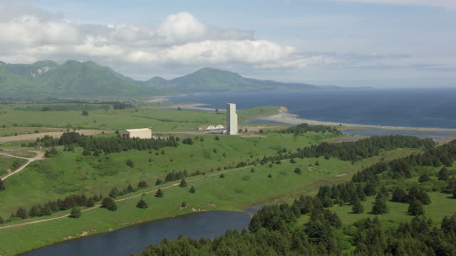 WS AERIAL View of flying over bluffs to Kodiak Launch Complex / Kodiak Island, Alaska, United States