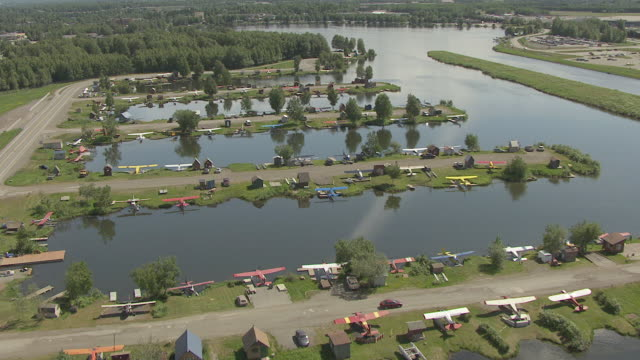 WS AERIAL ZI View of flying over docked airplanes at Lake Hood Seaplane Base / Anchorage, Alaska, United States