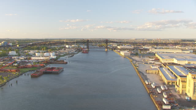 WS AERIAL View of flying over Passaic river with approach to helipad / Newark, New Jersey, United States
