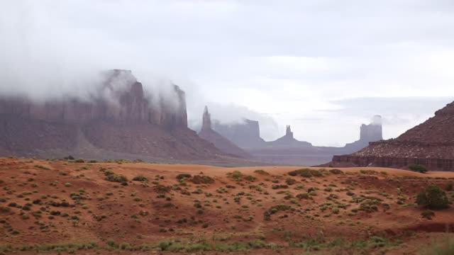 WS PAN View of fog coming off of monument valley / Monument Valley, Utah, United States
