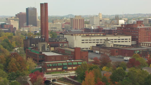 MS TU AERIAL View of following canal to BF Goodrich factory smokestacks / Akron, Ohio, United States