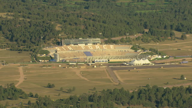 WS DS ZI AERIAL View of football field with air force sign on bleacher seats at air force academy / Colorado, United States