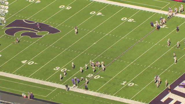 MS AERIAL ZO View of football players doing tackle practice at Billy Snyder Family Stadium / Manhattan, Kansas, United States