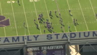 MS AERIAL View of football players practicing on field at Billy Snyder Family Stadium / Manhattan, Kansas, United States