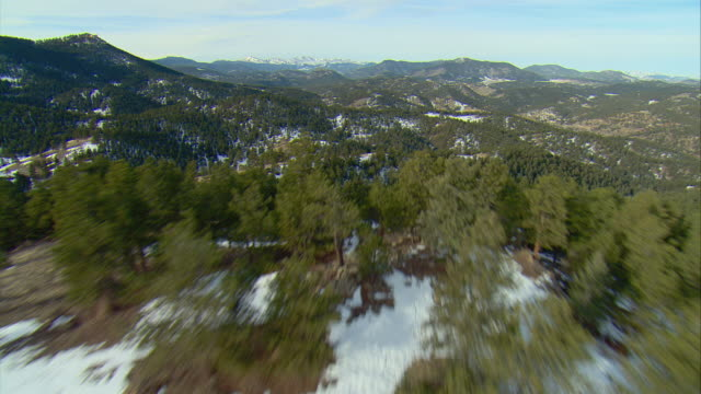 WS POV AERIAL View of forested ridgeline in Rocky Mountains outside Denver / Denver, Colorado, USA