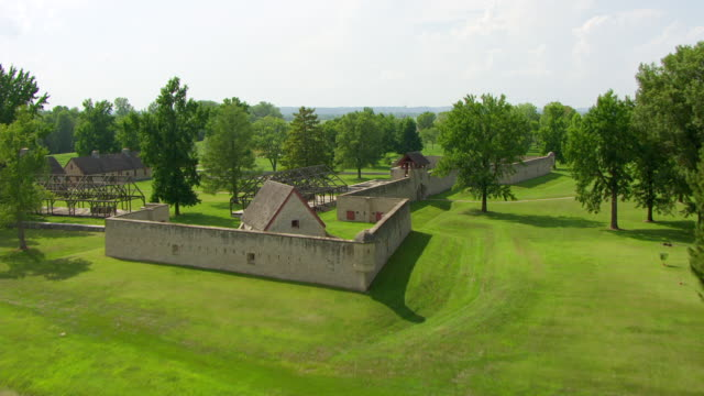 WS AERIAL POV View of Fort de Chartres area with base foundation of fort building and green field / Prairie du Rocher, Randolph County, Illinois, United States