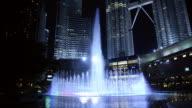WS View of Fountain Light Show at Petronas Towers / Kuala Lumpur, Malaysia