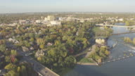 WS AERIAL View of Fox River and South Memorial Drive Bridge to WS downtown / Appleton, Wisconsin, United States