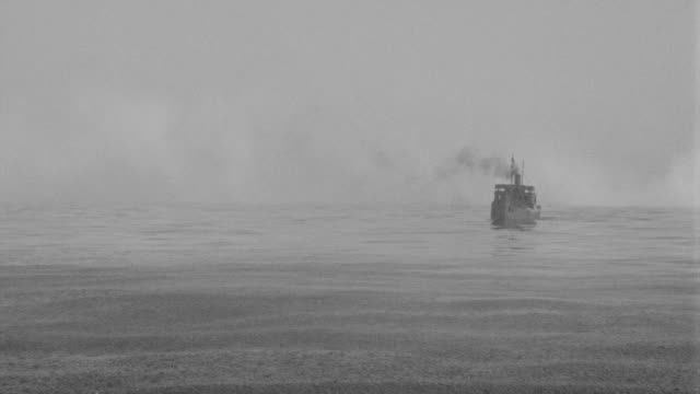 WS View of freighter in ocean coming toward, during heavy rain fall