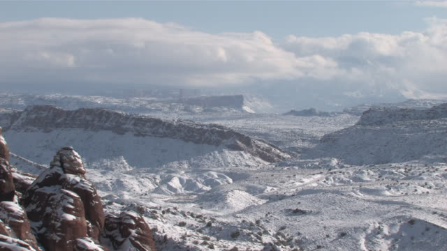 MS T/L View of Fresh Snow on Red Rock Desert, Natural Arch / Moab, Utah, United States