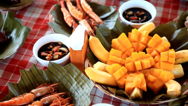 View of fruit bowl and seafoods on a table