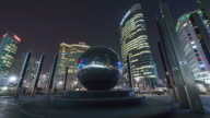 WS T/L PAN View of G20 Monument in COEX Convention Business Area at night / Seoul, South Korea
