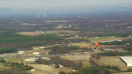 WS AERIAL View of Gaffney city with Peachoid Water Tower / South Carolina, United States