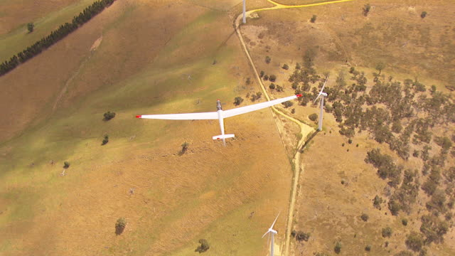 MS AERIAL TS View of glider plane and windmills / Macarthur, Victoria, Australia