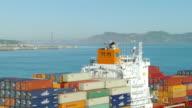 WS ZO AERIAL View of Golden Gate Bridge to sailing cargo ship / San Francisco, California, United States