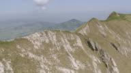 WS AERIAL View of Grassy and narrow summit ridge of Marwees in Alpstein with Lake Samtis and Hoher Kasten / Marwees, Appenzell Innerrhoden, Switzerland