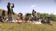 WS View of group of people picnic on wheat field / Middleburg, Virginia, United States