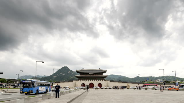 View of Gwanghwamun Gate (Gyeongbokgung Royal Palace's Front Gate and famous historical place in Seoul) with traffic and pedestrian