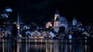View of Hallstatt across lake at night