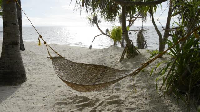 WS View of Hammock on beach / Malapasqua, Philippines