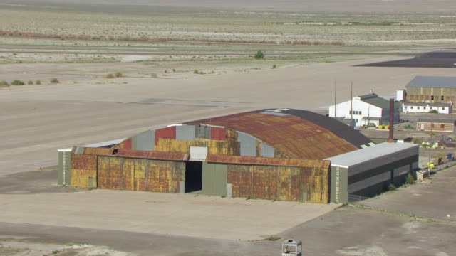 MS AERIAL ZI View of hangar entrance at Wendover airfield / Wendover, Utah, United States