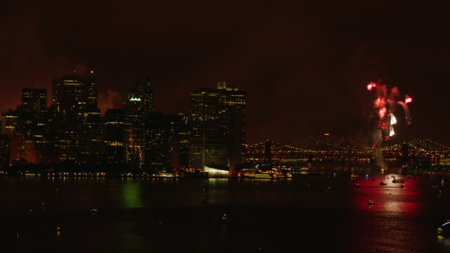 WS ZO AERIAL View of harbor and Brooklyn bridge with fireworks at night / New York City