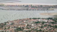 WS AERIAL View of harbor and town near coast / Basque Country, France