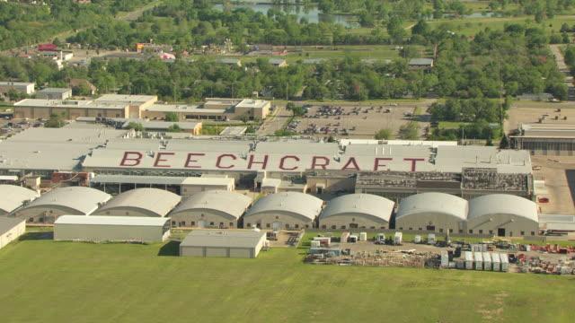 WS AERIAL View of Hawker Beechcraft hangars with plane on ramp / Wichita, Kansas, United States